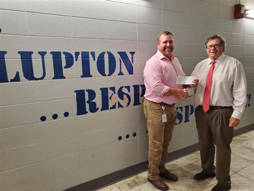 Tim Wadsworth presents check to LJH for STEM Program