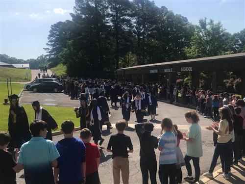 Dora High Seniors walk at Sumiton Middle School.