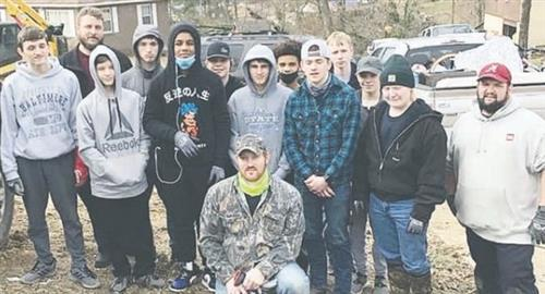 Dora High  School Wrestlers give a helping hand to  the community of Fultondale with the clean up after the tornado.