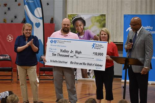 Valley Jr High Received a check for 10,000. for a new walking track.